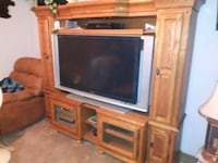 gray CRT TV with brown wooden TV hutch Menifee, 92584