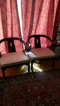 two brown wooden framed white padded armchairs Montreal, H3R 3L4