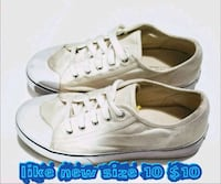 pair of white low-top sneakers 2056 mi