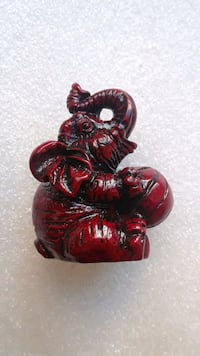 Mini Elephant Figurine holding Ball, Feng Shui