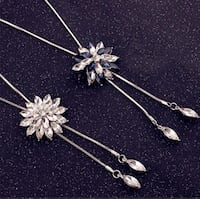 two silver-colored flower pendants Surrey, V3X 1P3