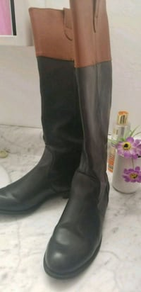 pair of black leather boots Toronto, M4H 1C6