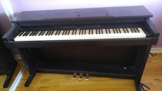 black wooden upright piano