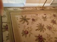brown and white floral area rug