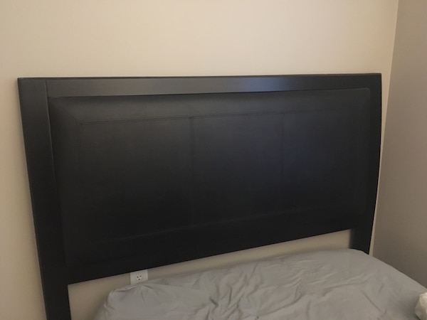 New condition leather and wood headboard.... needs e863731c-84b9-4fb3-9c64-40441d227ef6