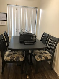 Rectangular brown wooden table with six chairs dining set El Cajon, 92020