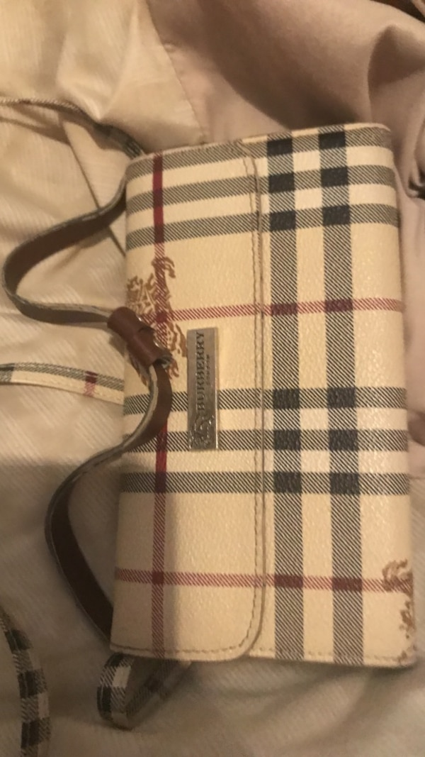 white and black Burberry leather crossbody bag