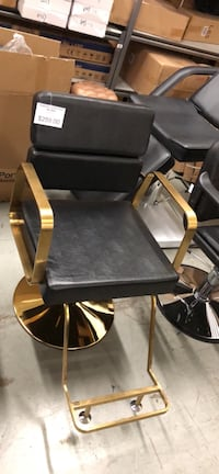 Brand new golden and black barber chair hair salon chair