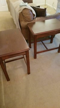 two rectangular brown wooden side tables