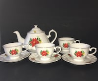 Belk Poinsettia Tea Set. Teapot, 4 tea cups and 4 saucers $35. Excellent condition. Dallas, 75235