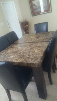 brown and black marble top table with chairs Land O' Lakes, 34638