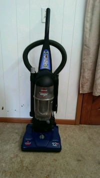 blue and black Bissell upright vacuum cleaner Tulsa, 74112