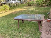 """Patio table. 60"""" L x 38"""" W. Glass top. PVC frame can be painted."""