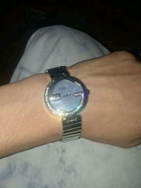 round silver analog watch with link bracelet El Centro