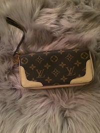 monogrammed brown and black Louis Vuitton leather crossbody bag 28 km