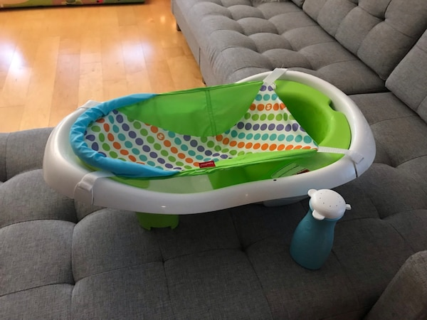 Baby bathtub with infant sling and bottle sprayer