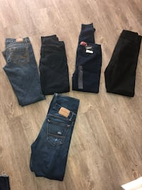 two blue and one black jeans 1484 mi