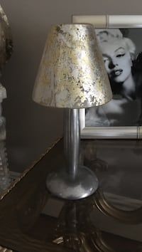 Metal base tea light with gold & silver glass shade
