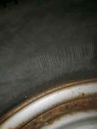 gray and black vehicle tire 879 mi