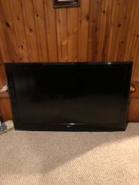 black flat screen TV with remote District Heights, 20747