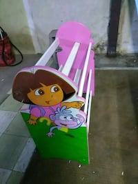 white and purple wooden dora-printed shoe rack
