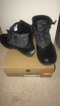 pair of black Adidas high top sneakers on box Columbia, 21045