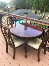 oval brown wooden table with four chairs dining set Manassas, 20109