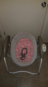 baby's gray and pink swing chair