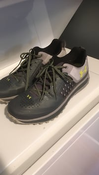 Pair of black-and-gray under armour leather low-top sneakers