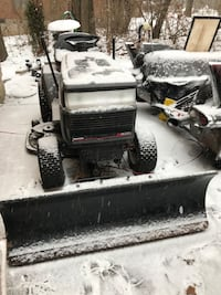 Moving must sell tractor with Plow and Mower deck
