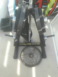 black Ivanko Barbell Company weight plates