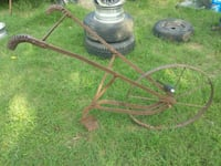 Old time push garden plow Rogers, 72756