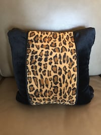 Black pillow with animal print and 4 tassels from smoke free home Frederick, 21701