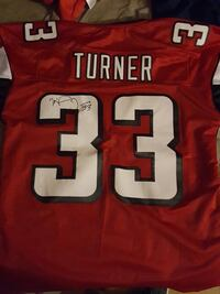 Two hand signed Michael Turner jerseys  Cary, 60013