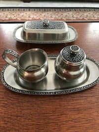 "Oneida Custom 18/8 stainless serving items. Butter dish with glass insert is 8 3/4"" x 4 1/2"". Creamer is 4"" x 2 1/2 x 3 1/2"". Sugar bowl with lid is 4"" x 2 1/2"". Tray is 10 3/4"" x  5"". All have decorative flower band. Rarely used. Sterling, 20164"