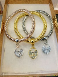 Rose gold, gold and silver heart bracelets Toronto, M5M 1T2