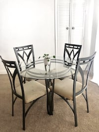 round glass top table with four chairs dining set