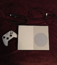 white Xbox One console with controller null