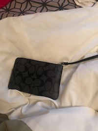 black and gray Coach wristlet Tampa, 33647