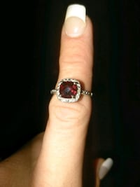 silver and red gemstone ring 1962 mi