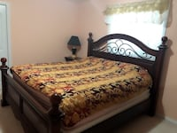 brown wooden bed frame with white and red floral bedspread Edmonton, T5Z 3Z5