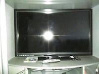 black flat screen TV with remote New York