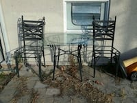 Cast iron table with glass top and four chairs Bradenton, 34209