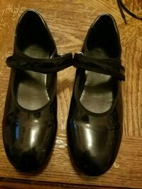pair of black leather mary jane shoes Charlotte, 28269