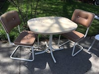 Round white metal patio table with four chairs Point Edward, N7V 1E3