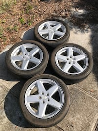 Four 18 inch Jeep rims; 215/55/R18 Tires.(: Lake Wales
