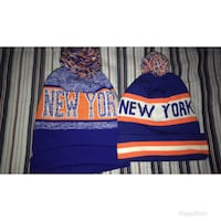 two blue-and-orange New York-printed beanies