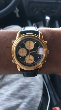 round gold-colored chronograph watch with black leather strap Los Angeles, 90027