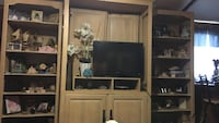 flat screen television with brown wooden TV hutch Yulee, 32097