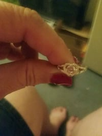 gold-colored ring with clear gemstones Leland